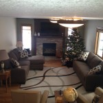 Living room remodel with stone fireplace surround